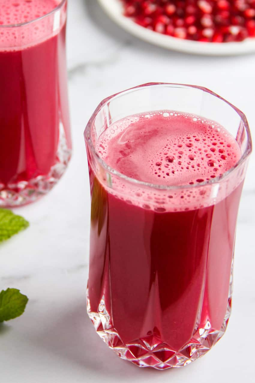homemade pomegranate juice served  in a glass