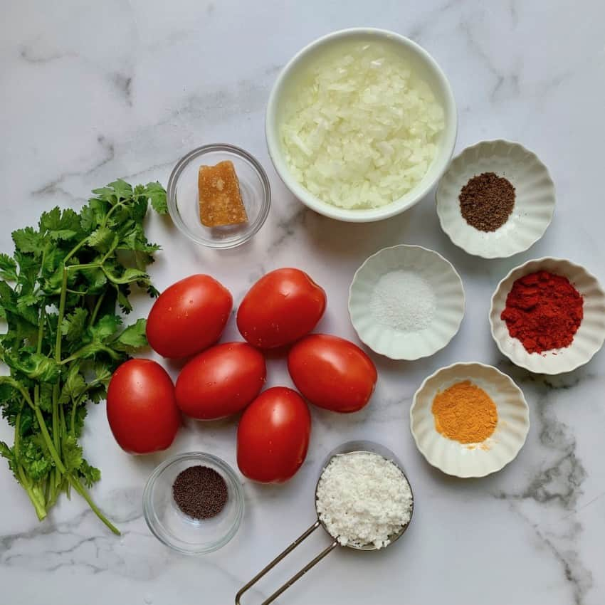 Ingredients for stuffed tomatoes on a white board