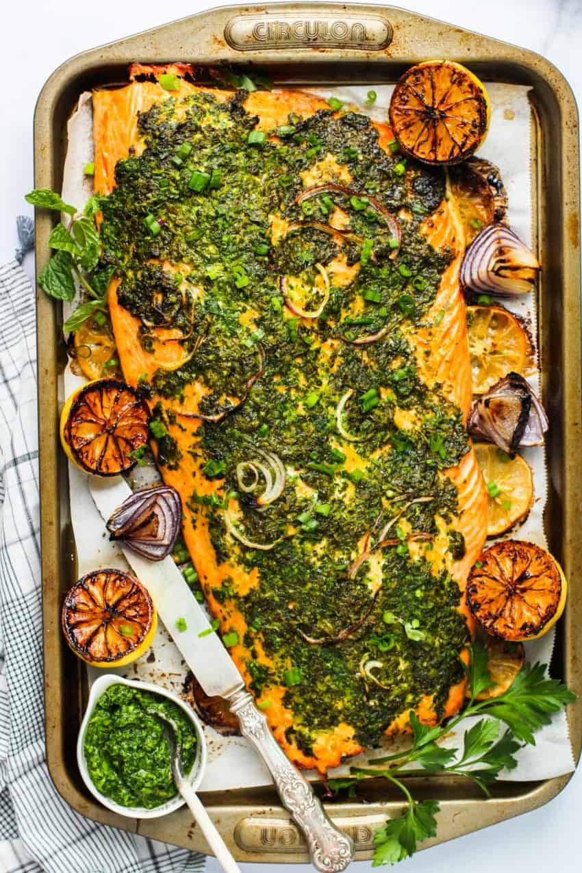 Baked salmon with green marinade on a tray