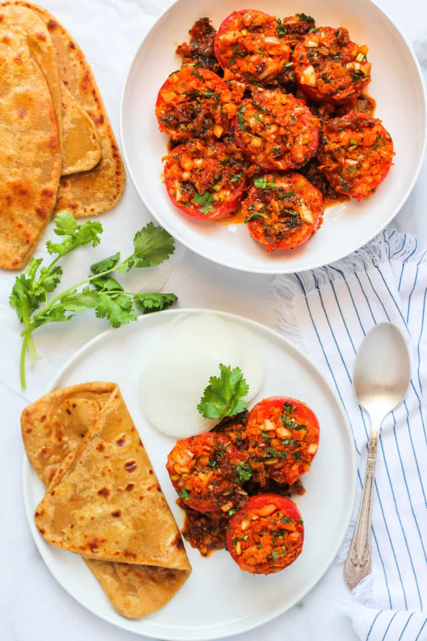 Healthy stuffed tomatoes served with parathas