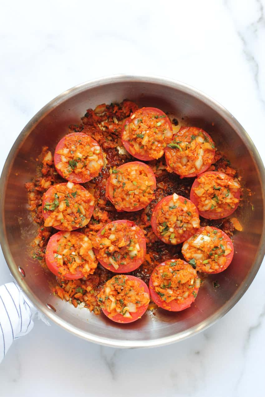 cooked tomatoes in a frying pan