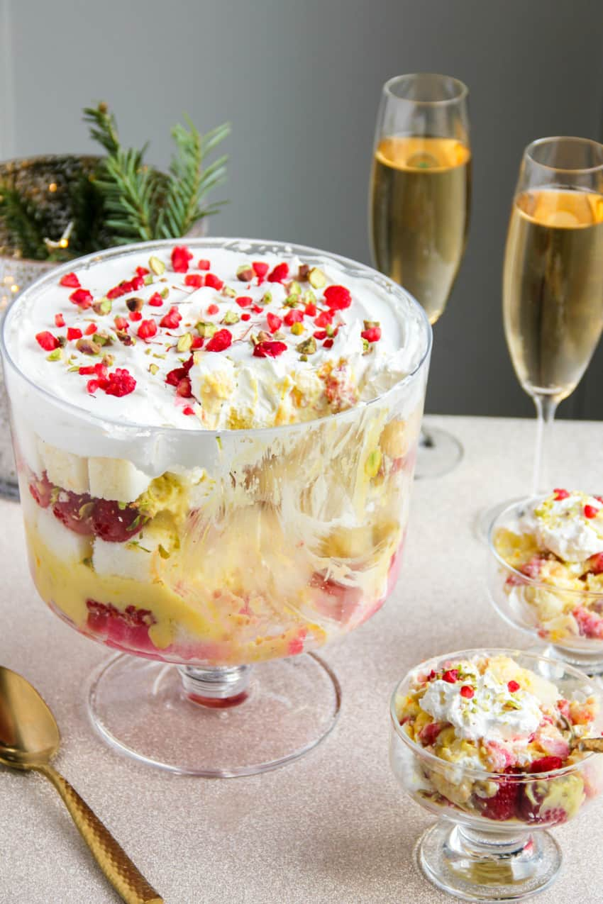 Raspberry trifle in a trifle bowl and serving bowls