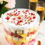 A show stopper dessert, this no-cook Raspberry Trifle is layered with light angel food cake, cardamom & saffron infused pudding, pistachios and cream.