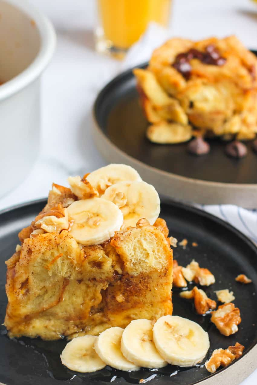 Bread Pudding topped with maple syrup and bananas