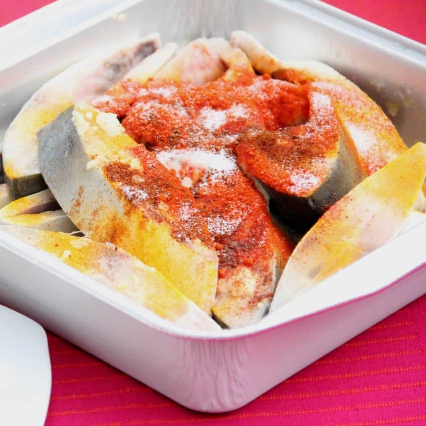 Pompano fish in a tray with spices