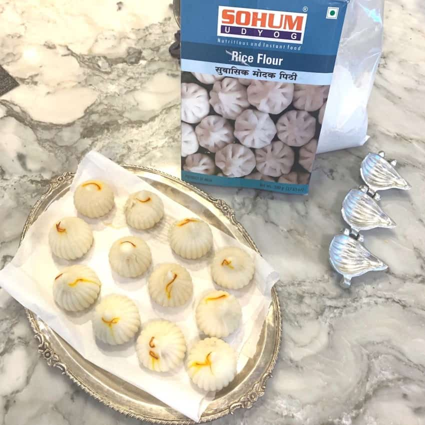 Ukadiche Modak next to rice flour pack and mould