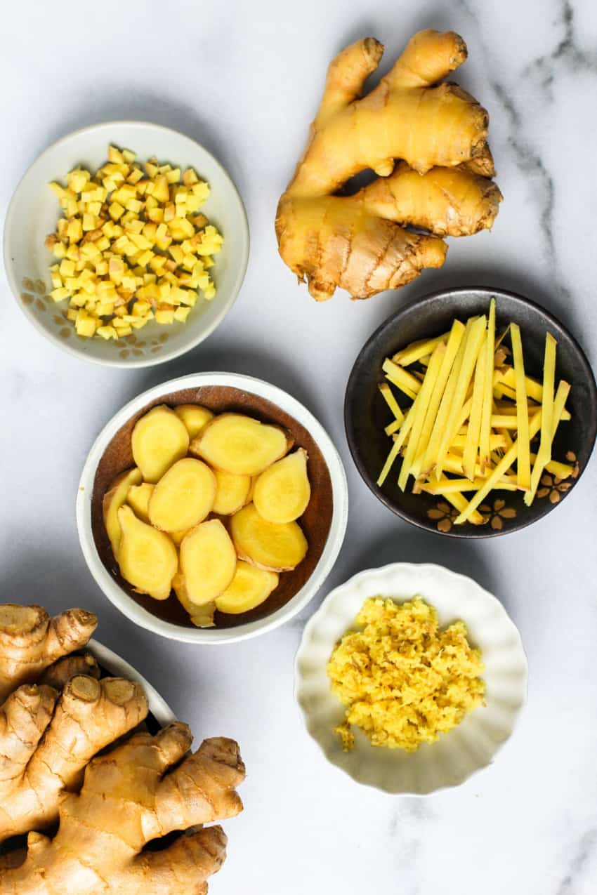 whole ginger root, slices, diced, silvers and paste in bowls