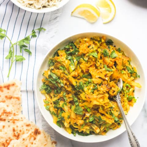 Cabbage stir fry served with naan and rice