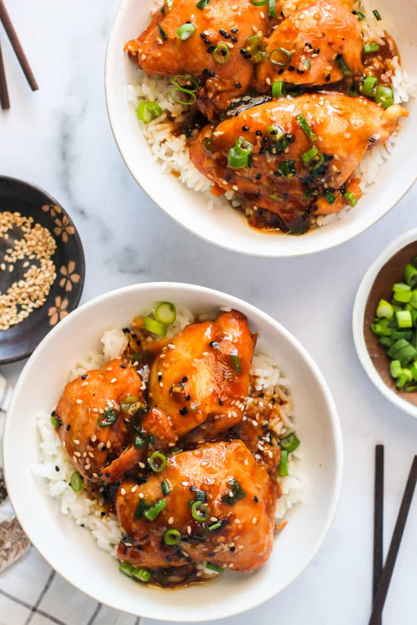 Chicken Teriyaki served in 2 white bowls with rice