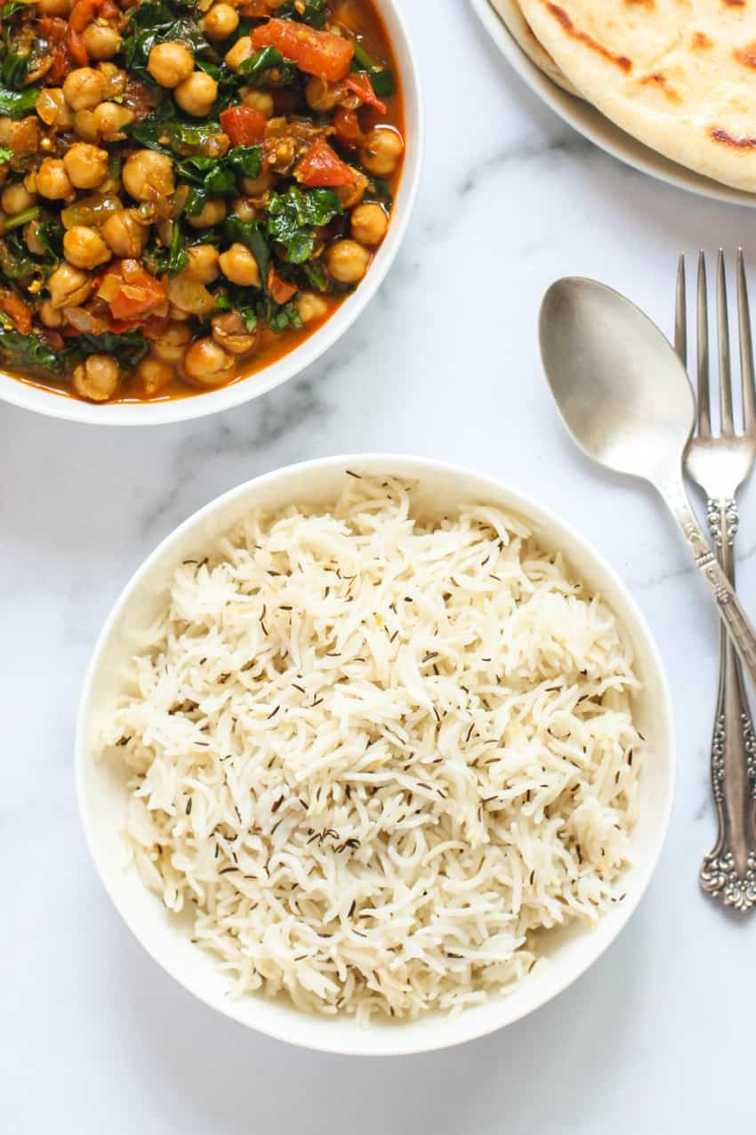 jeera rice served with chickpea curry