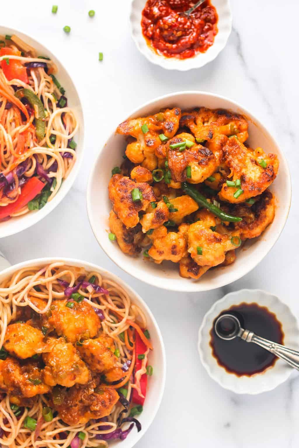 Gobi Manchurian served over hakka noodles