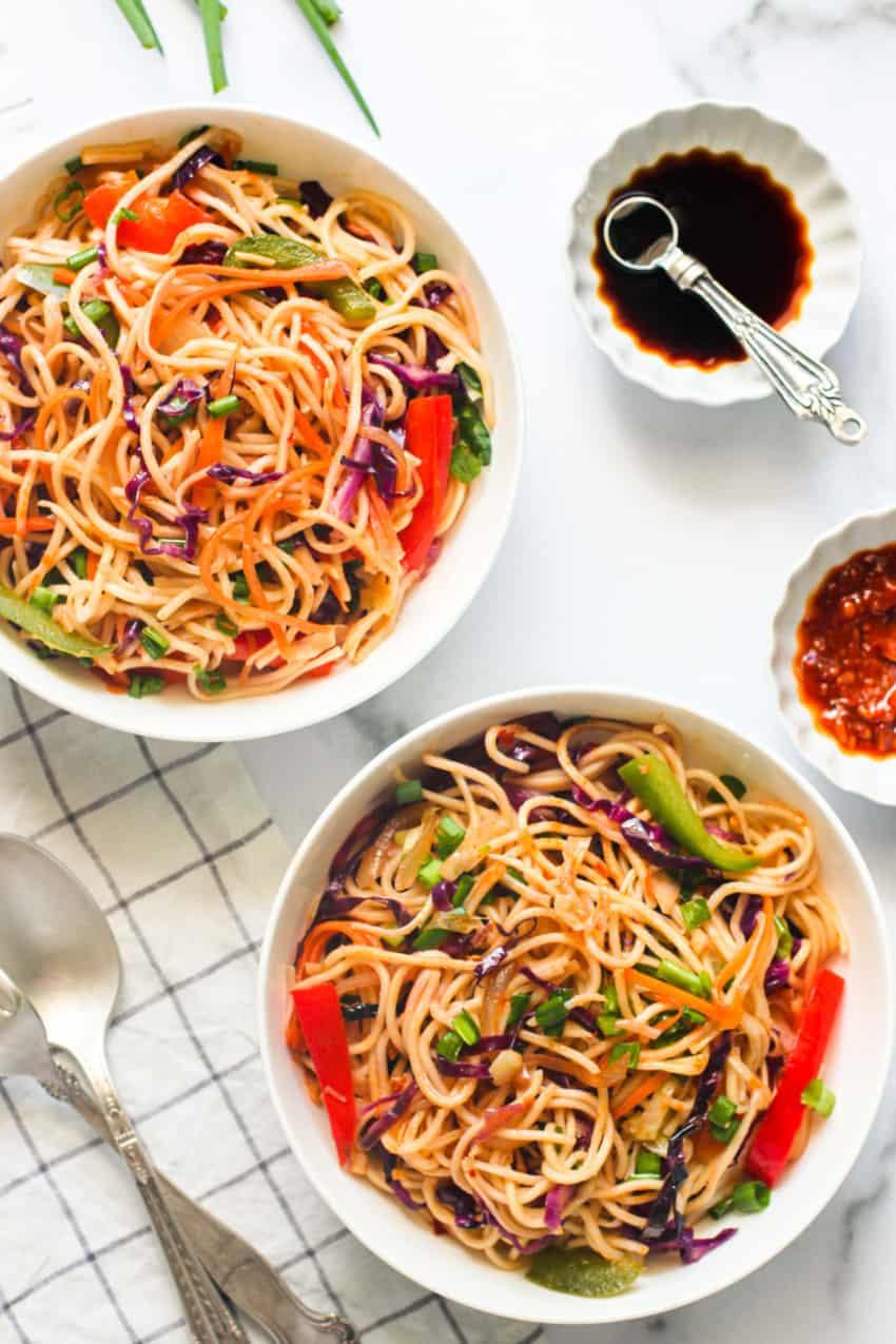 Veg Hakka noodles in 2 white bowls