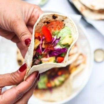 fish taco in hands