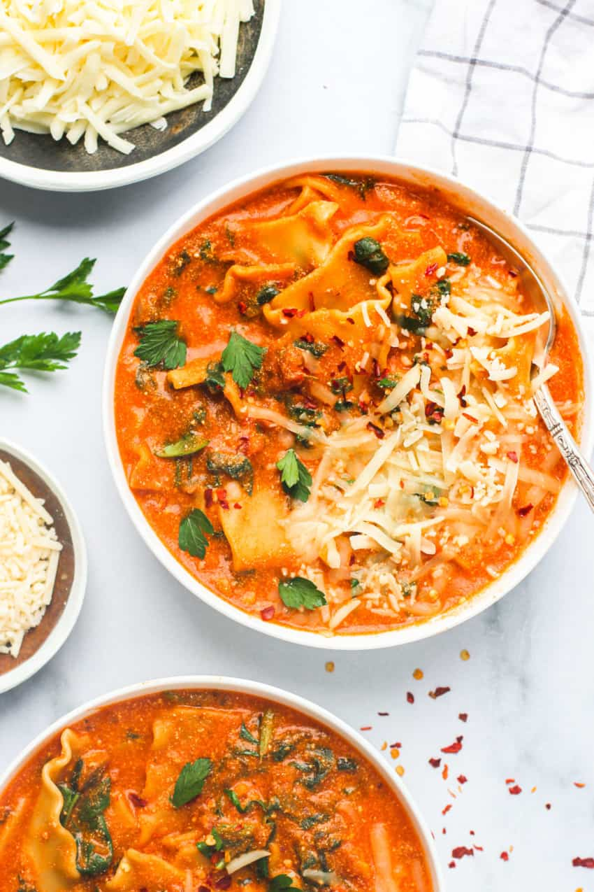 lasagna soup in white bowl with spoon in it