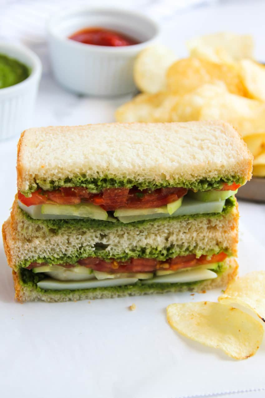 stacked up chutney sandwich  with potato chips