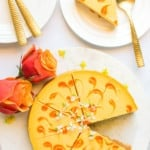 mango cheesecake with a slice served in a plate