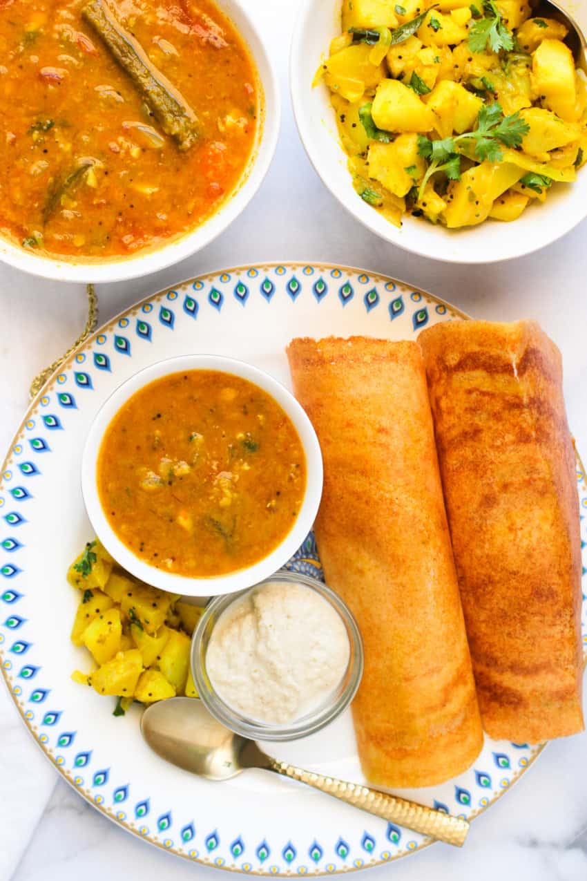 quinoa oats dosa served with sambar, chutney & curried potatoes