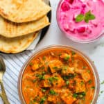 paneer butter masala served with naan and raita