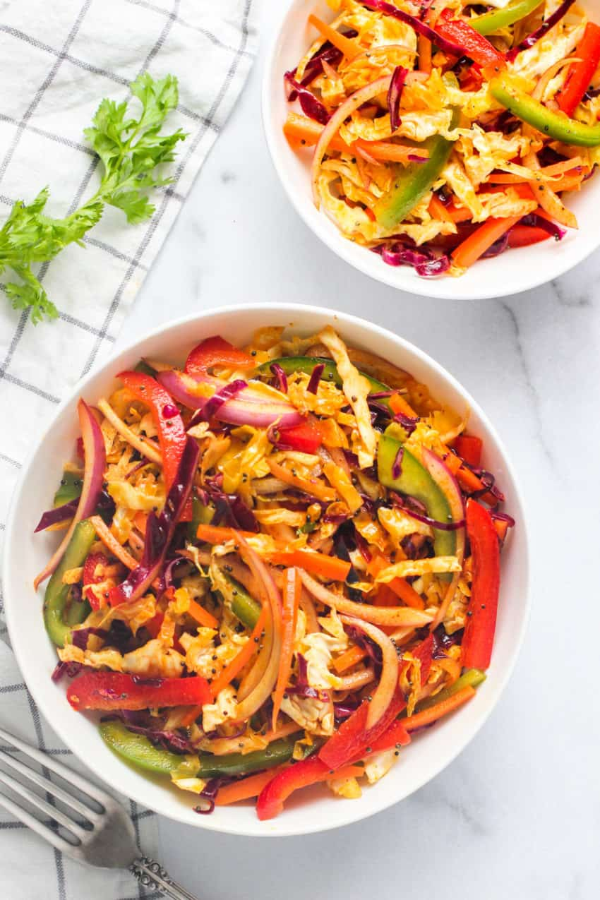 Cabbage salad in 2 white bowls