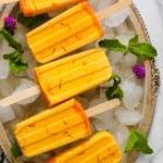 mango ice pops in a silver tray