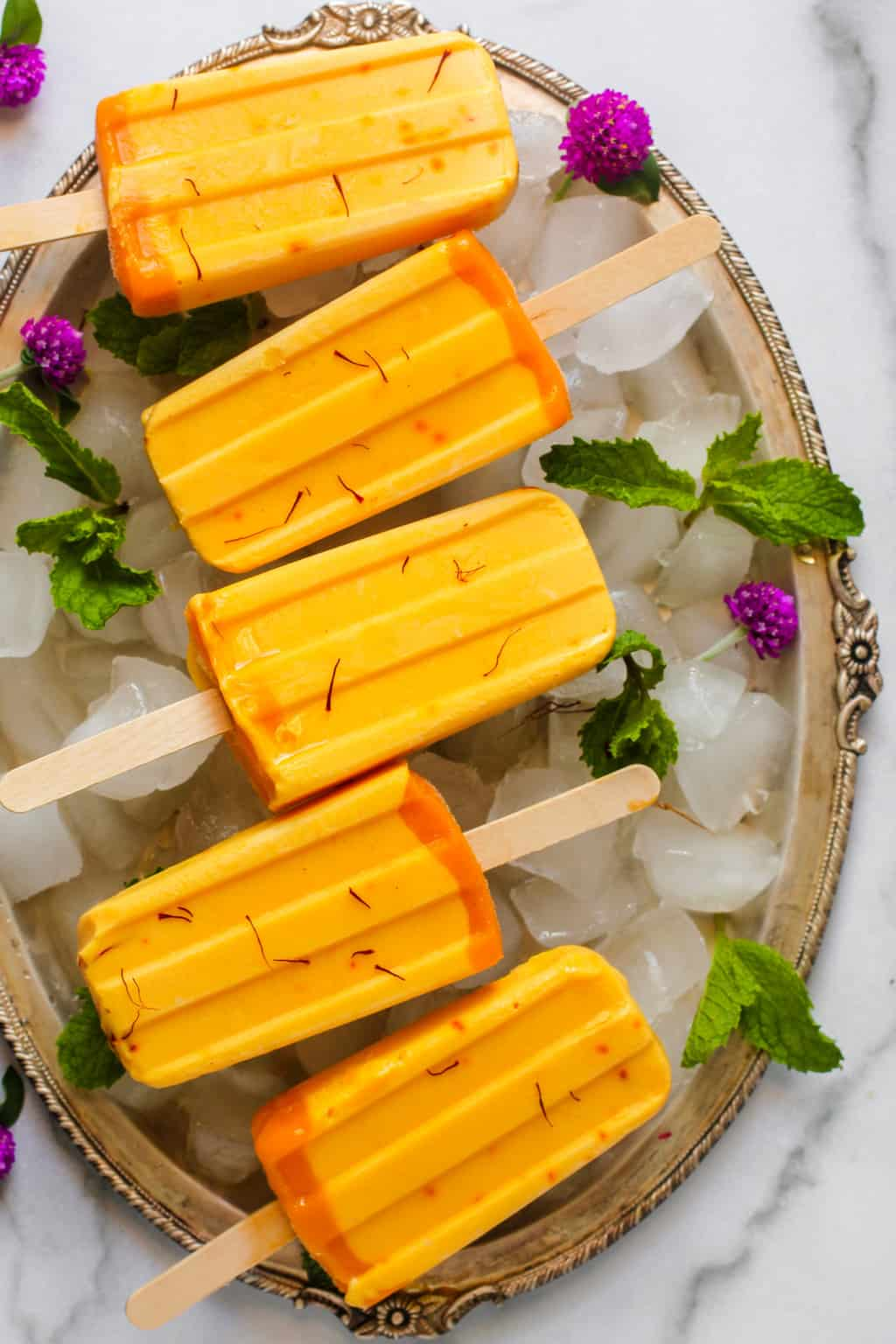 mango ice pops in a silver tray