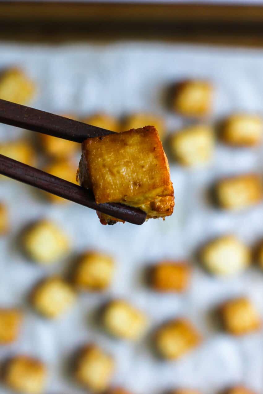 pan fried tofu with chop sticks