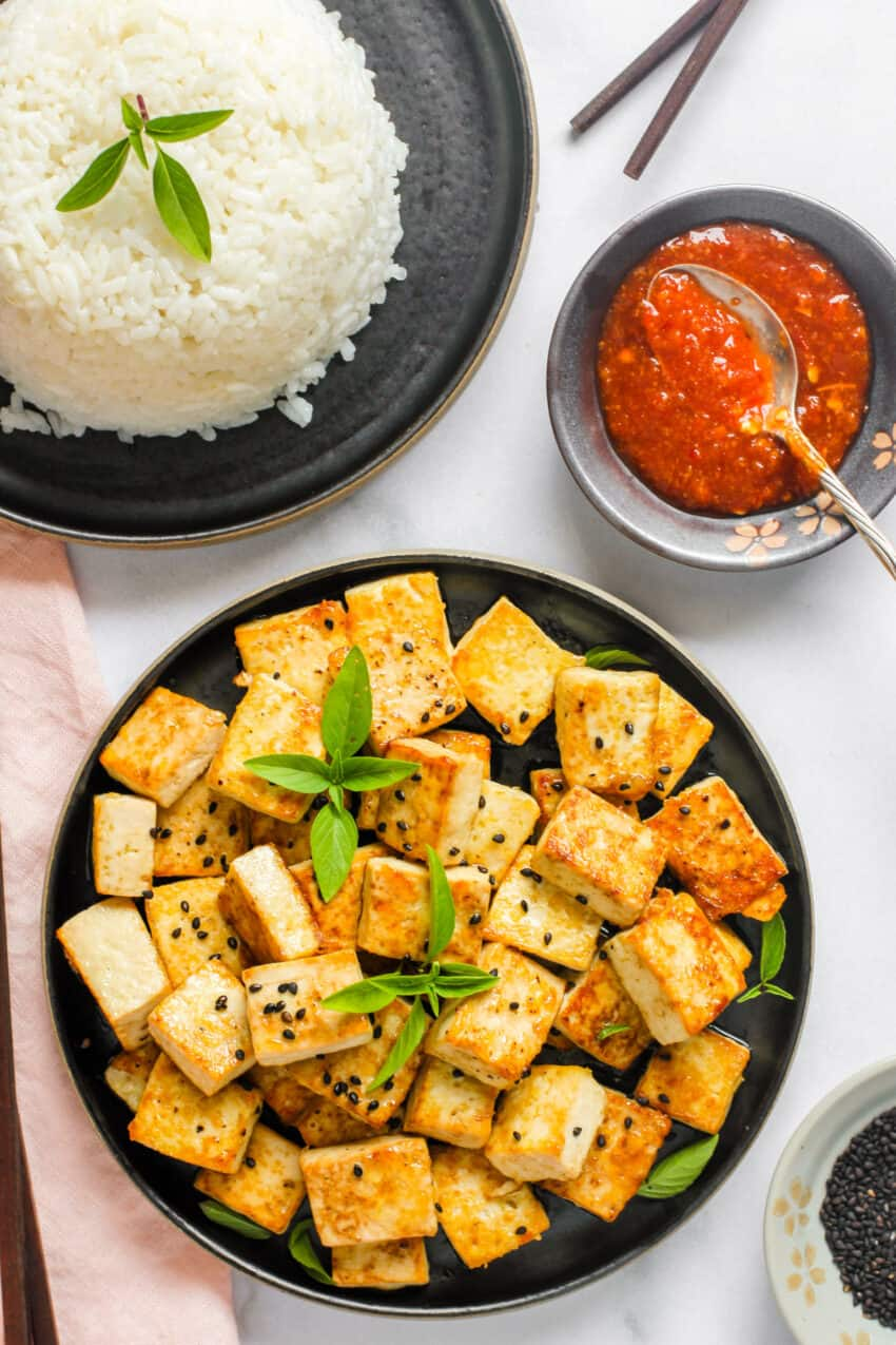 Baked tofu with steamed rice and hot sauce