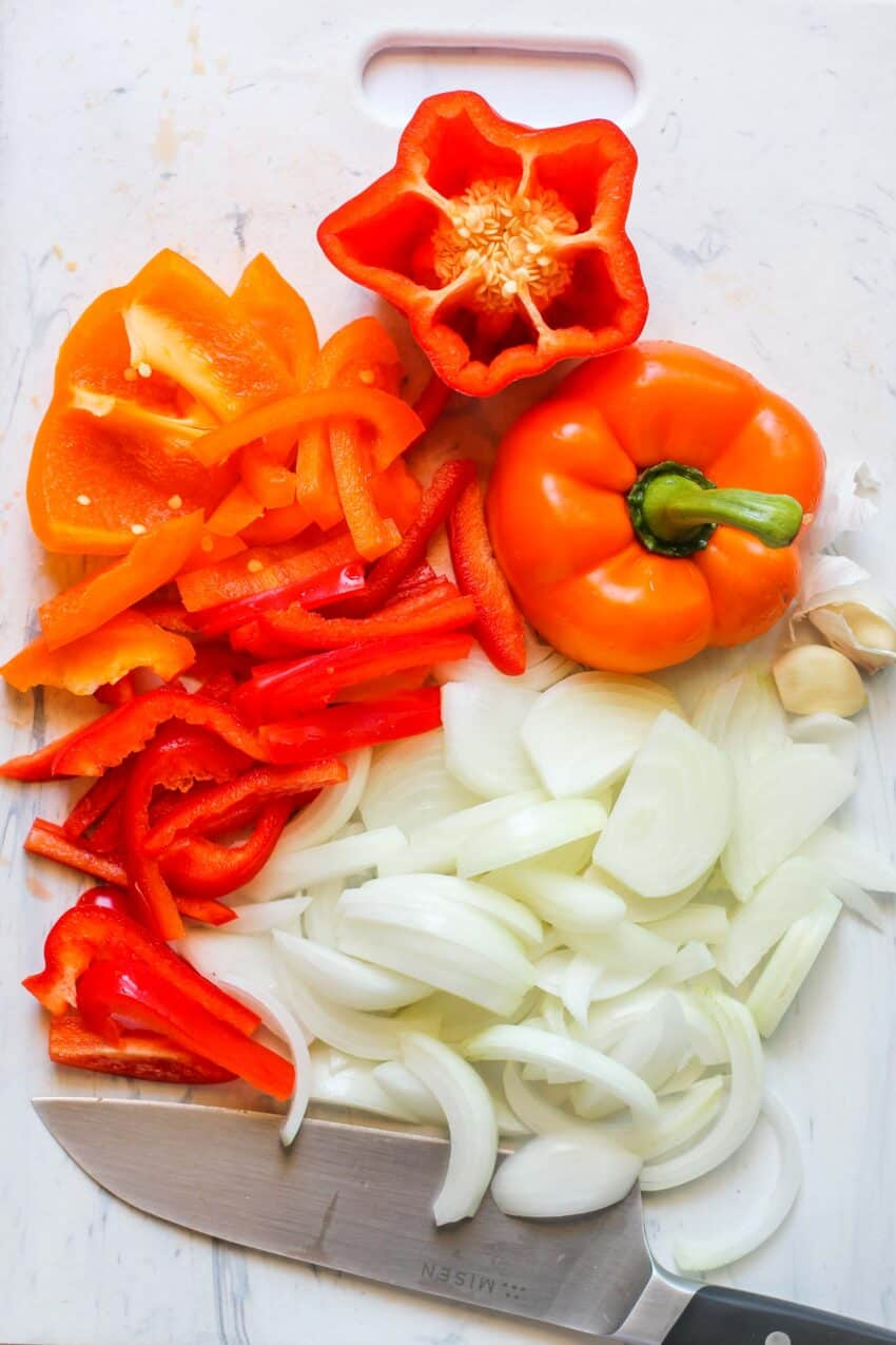 onions and peppers on a cutting board