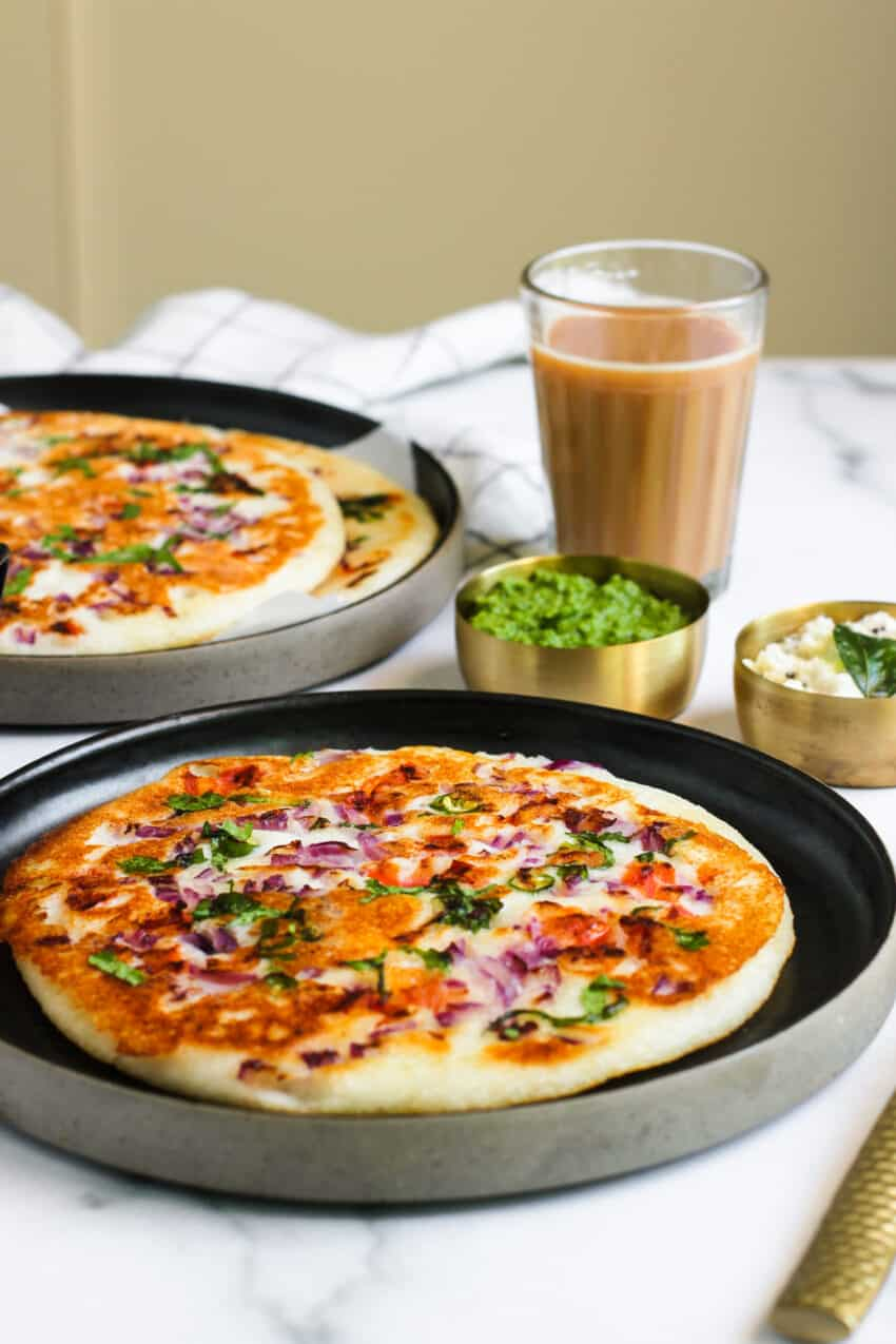 Uttapam served with chutneys and tea