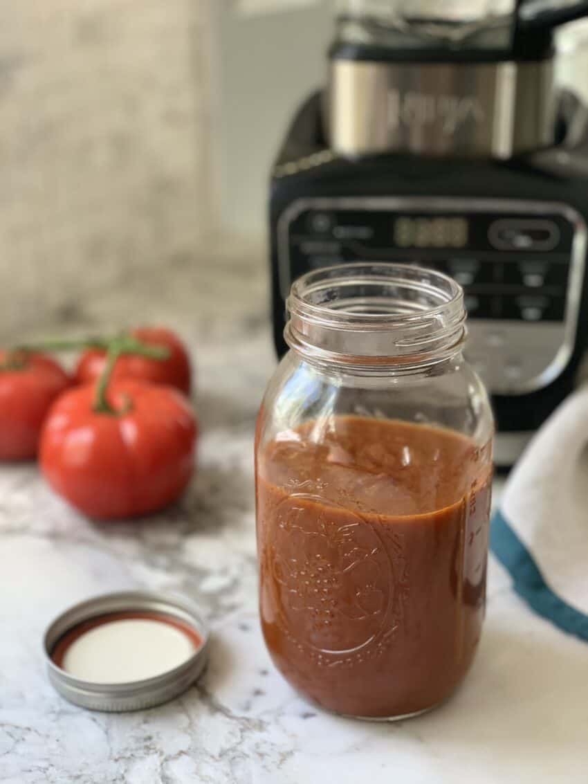 Enchilada sauce jar next to a blender