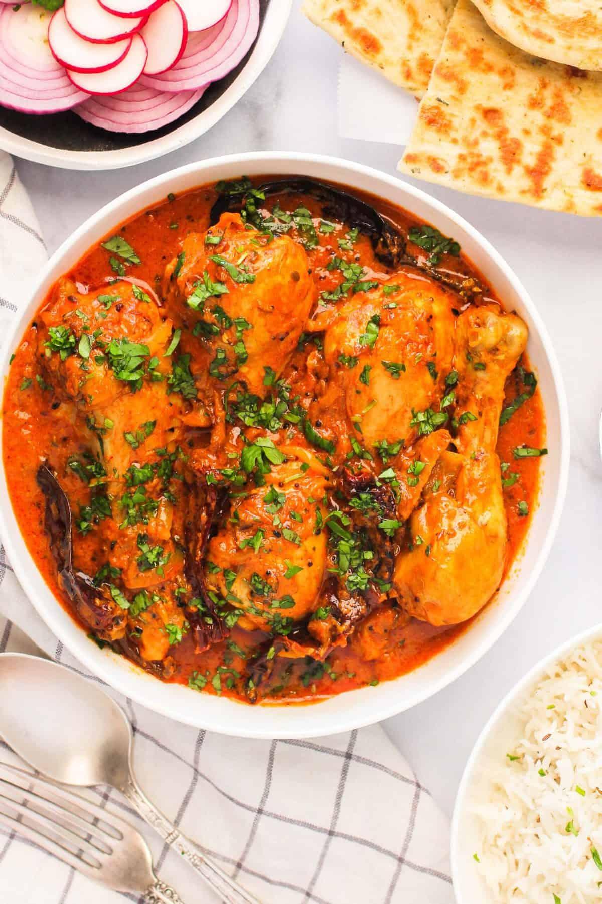achaari chicken curry with rice & naan