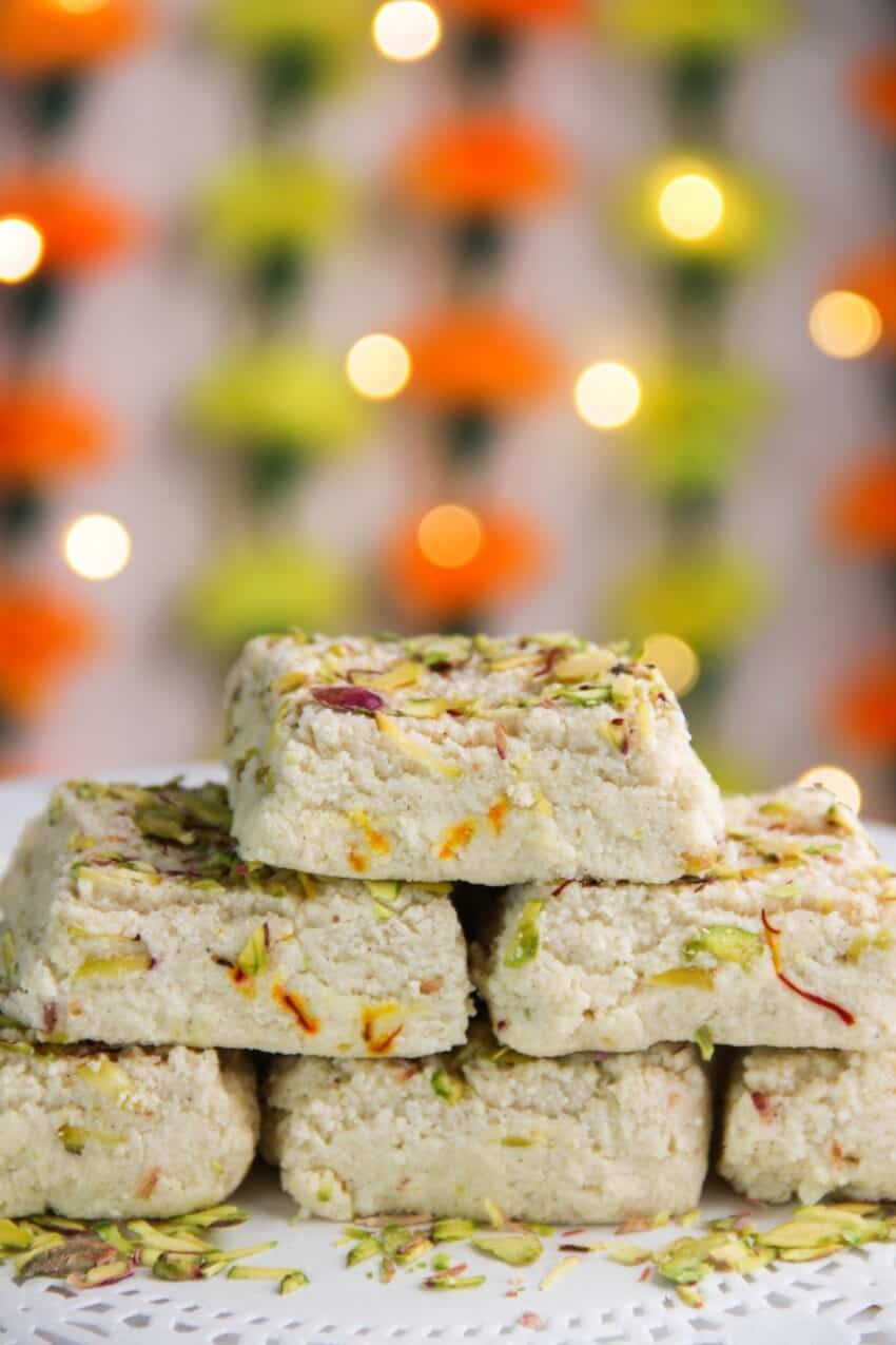 stack of kalakand cubes with a festive back drop