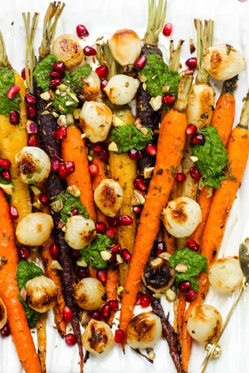 Roasted carrots and pearl onions garnished with chutney, pistachios and pomegranates