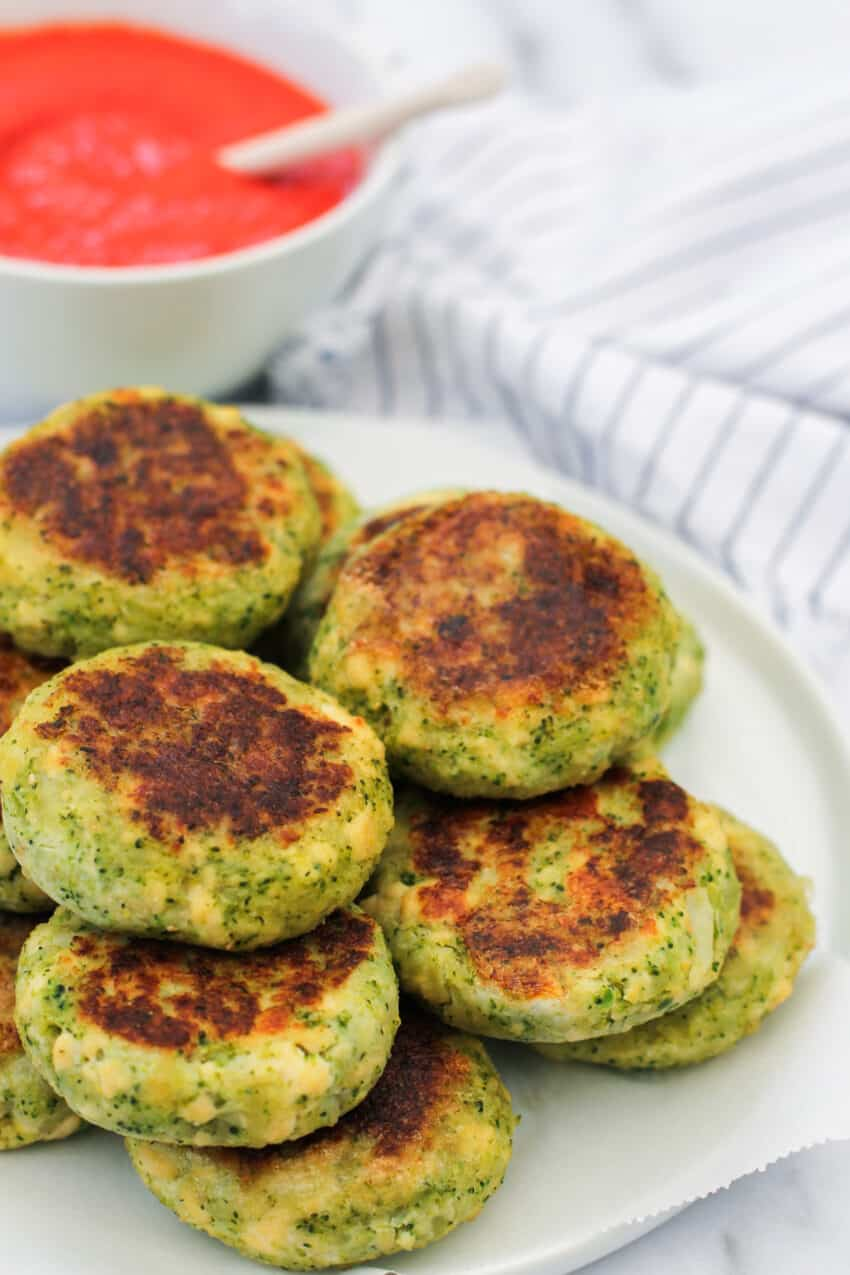 broccoli and tofu patties stacked on white plate