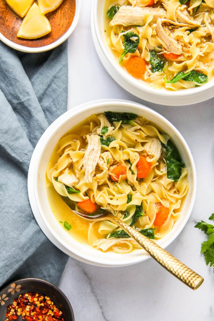2 bowls of chicken noodle soup with kale