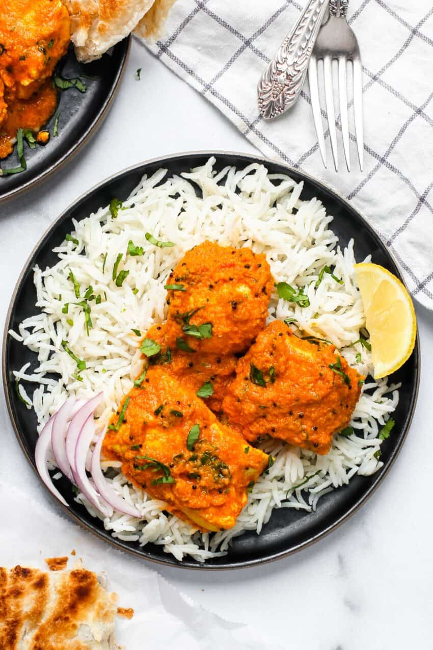 fish curry served with basmati rice