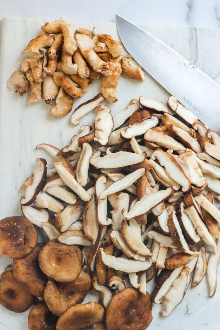 Sliced shiitake mushrooms on a cutting board