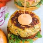 salmon burger with drizzle of sriracha mayo