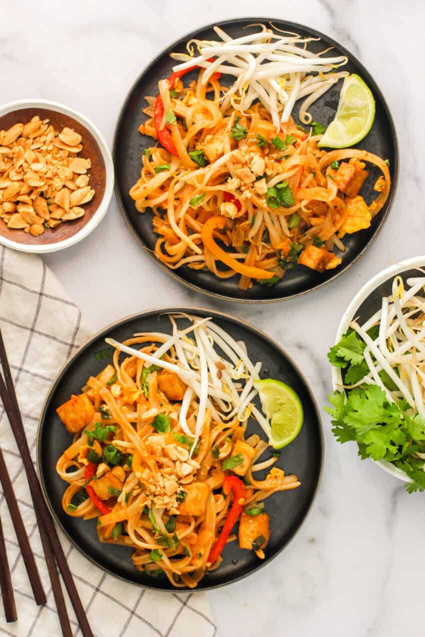 Pad Thai served with bean sprouts and lime wedges