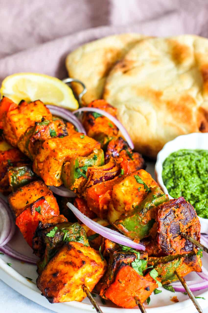 paneer skewers served with naan and mint chutney