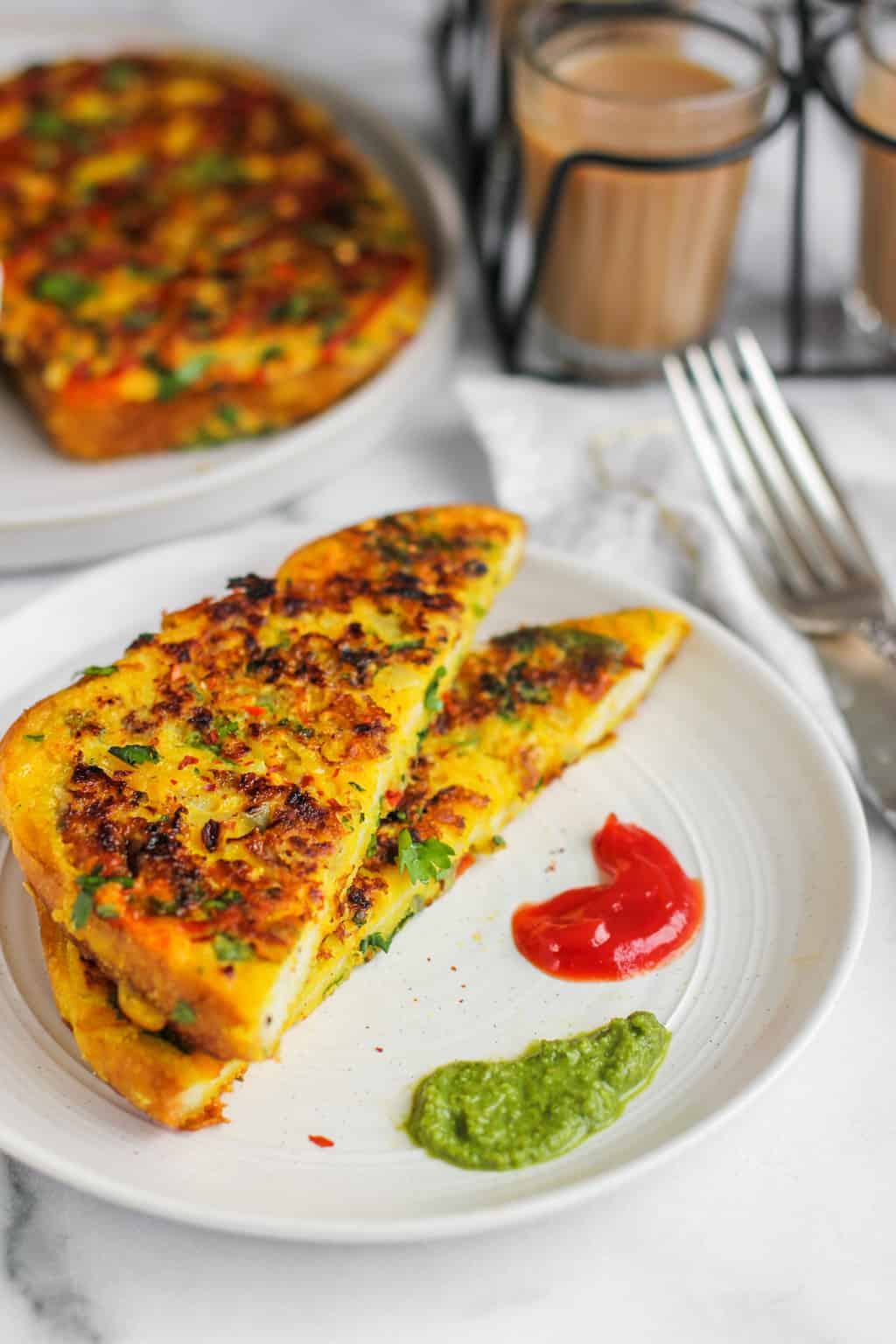 masala french toast served with chutney and ketchup