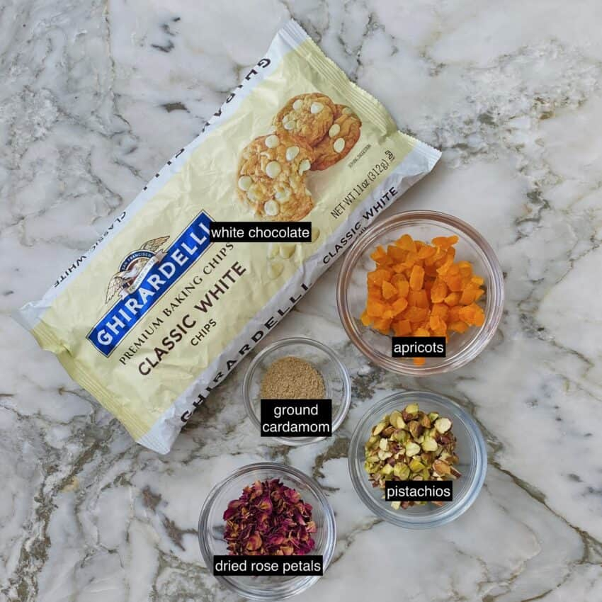 Ingredients - white chocolate chips, apricots, ground cardamom, pistachios, rose petals