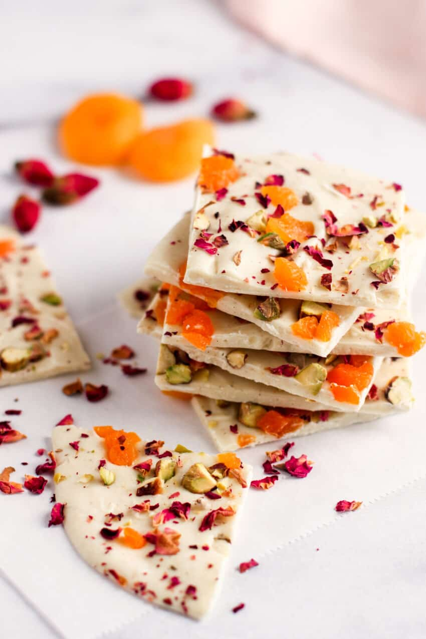 white chocolate bark with pistachios, apricots and rose petals on parchment paper