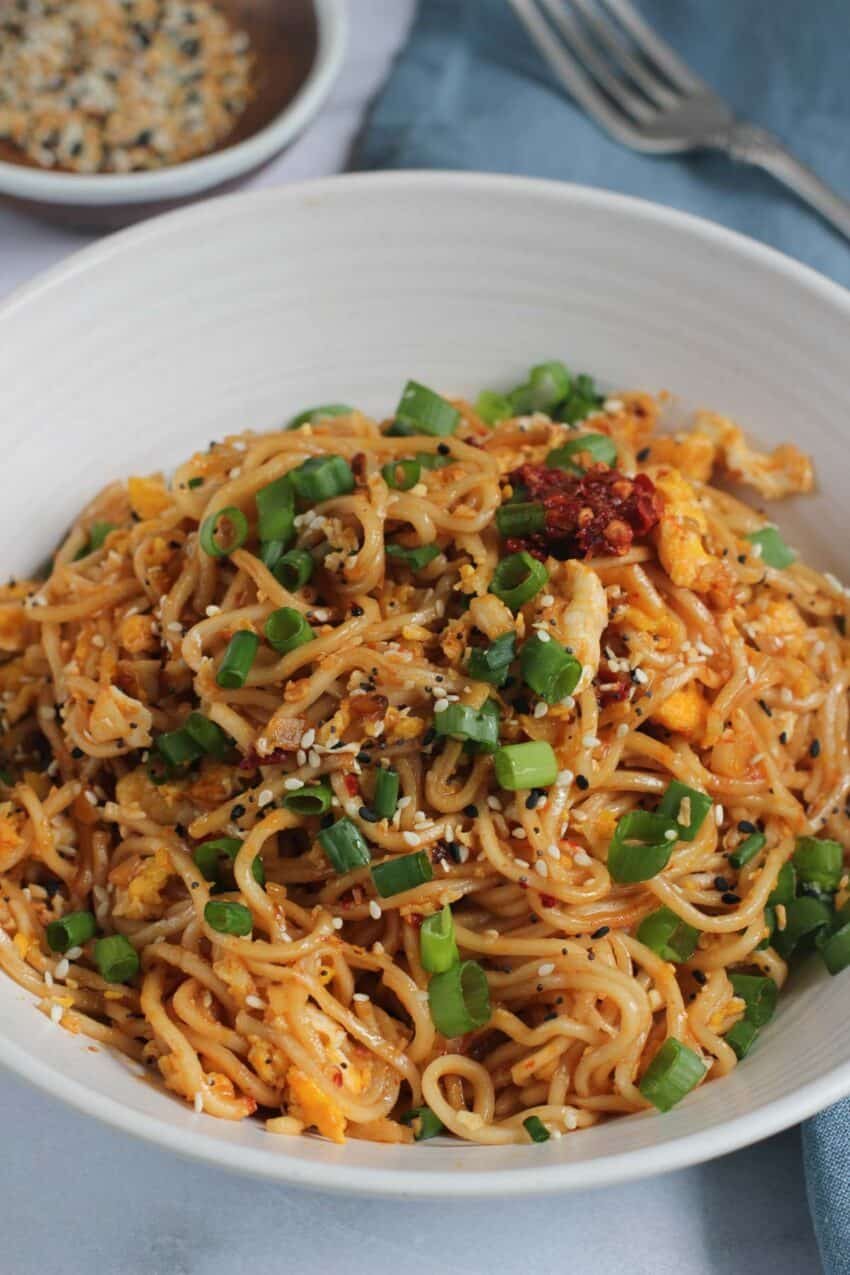 Tik tok trending Ramen Noodles in a bowl with chutney and scallions