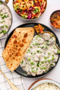 mushroom matar malai served with paratha, rice and cabbage salad