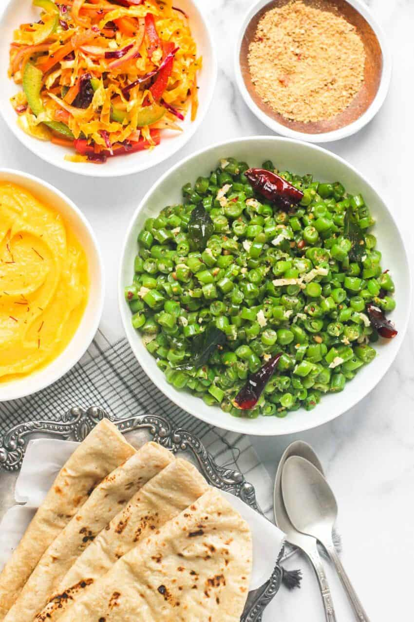 South Indian green beans served with cabbage salad, shrikhand, roti and masala powder
