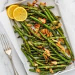 air fried green beans served with sliced lemon