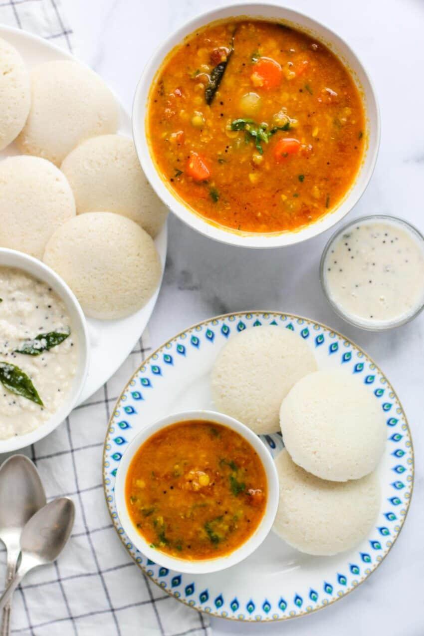 idlis served with coconut chutney and sambar