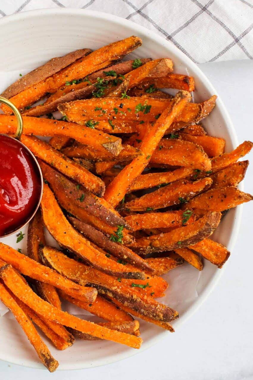 sweet potato fries served with ketchup