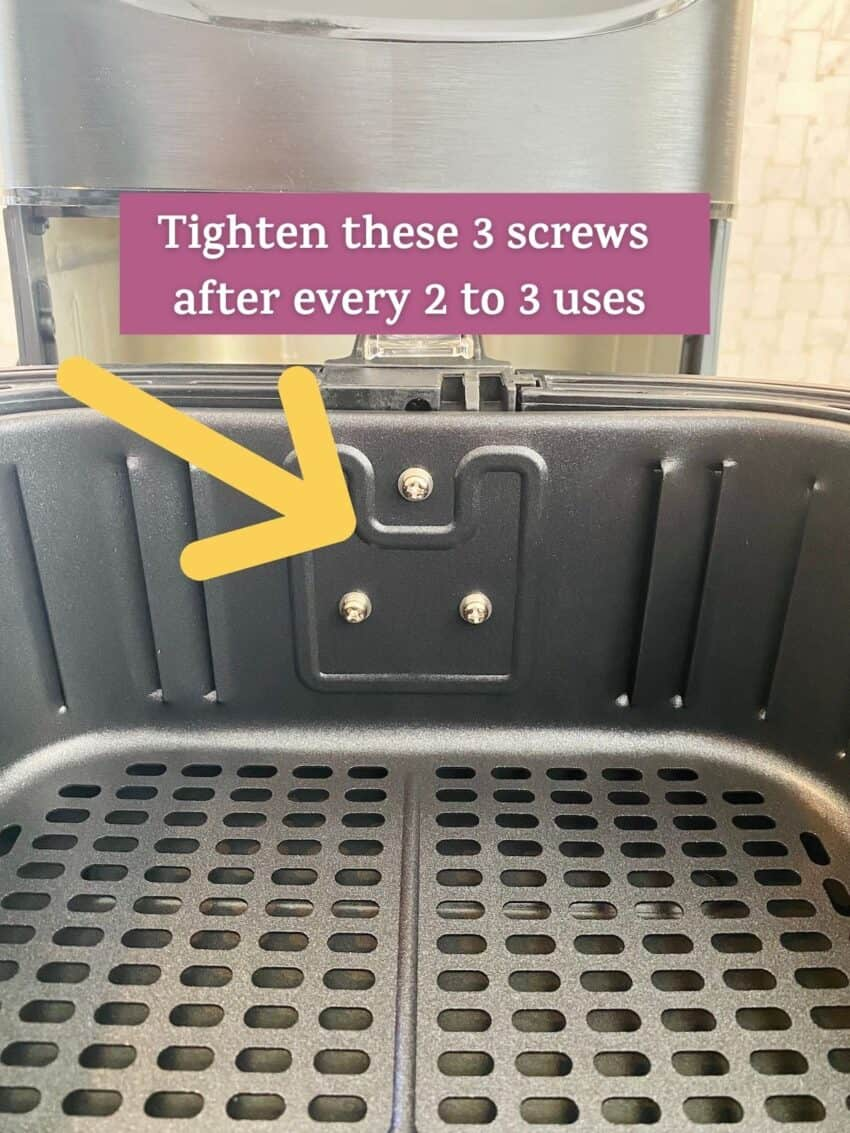 cosori airfryer basket showing the screws inside that need to be tightened